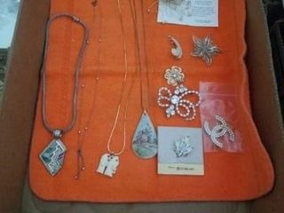 A VARIETY NECKlACES  BROOCHES