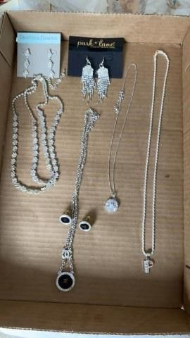 SIlVER NECKlACES AND EARRINGS
