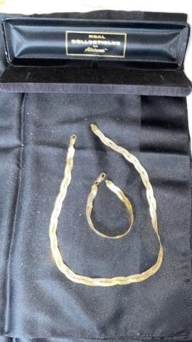 GOlD NECKlACE AND BRACElET BY ADRIENNE