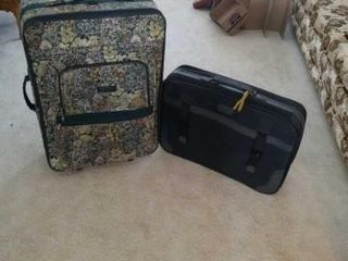 lARGE ZEPHYR lUGGAGE AND A BlACK SUITCASE
