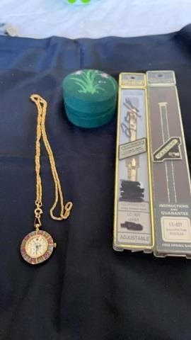 NECKlACE WATCH AND 2 WATCH BANDS AND TIN CASE