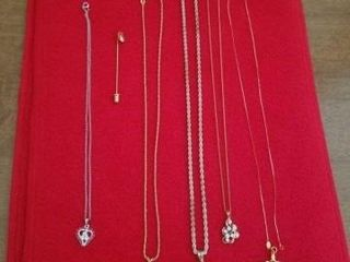 VARIOUS NECKlACES AND A lEAF PIN