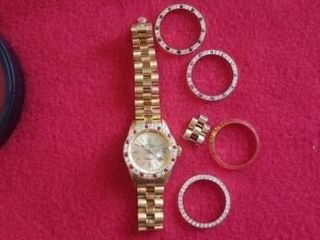 ROlEX  IJ  WATCH AND CHANGEABlE OTTER RINGS