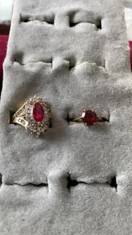 GOlD BANDS WITH RED STONES  1 CIRClED WITH JEWElS