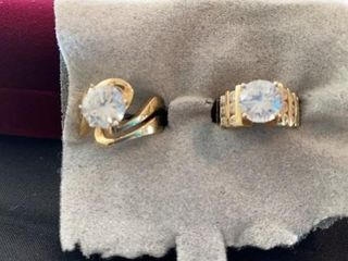 lARGE GOlD BANDS WITH DIAMOND lOOKING OVAl
