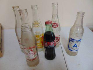 assortment of vintage pop bottles