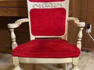 Red velvet upholstered chair