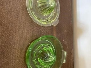 1 green and 1 yellow depression glass reamers