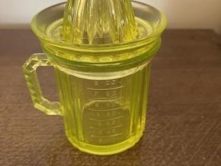 Depression yellow glass reamer and measuring cup