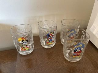 9  vintage Mickey Mouse collectors cups from