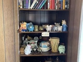Piggy banks  brass candy dishes  books and