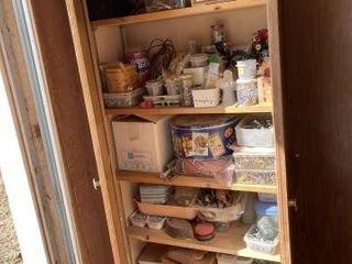 Contents of 4 cabinet doors plus top storage