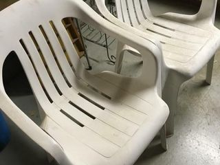Four plastic lawn chairs
