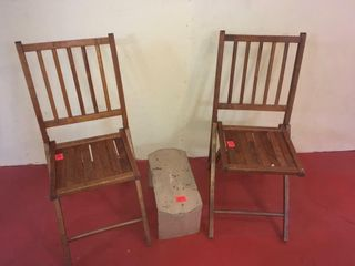 Two folding wooden chairs