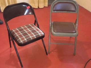 Two metal folding chairs