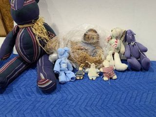 Assorted fabric stuffed animals with doll made from straw