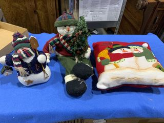 Snowman themed pillow and plush statues