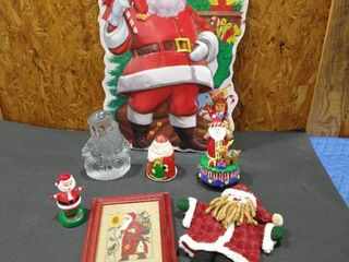 Music playing Santa Claus statue with assorted Santa Claus themed decor