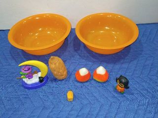Assorted Halloween figurines with two orange bowls