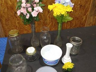 Assorted glass vases and jars with flowers and marbles