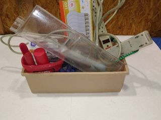 Assorted light bulbs  power cords and more with tray