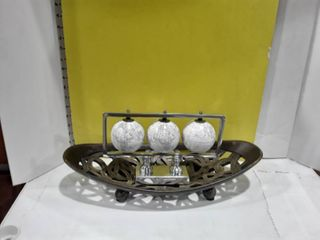 Oval shaped bowl and 3 small globes on a stand