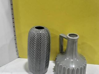 2 grey colored vases