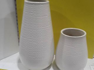 2 white colored vases