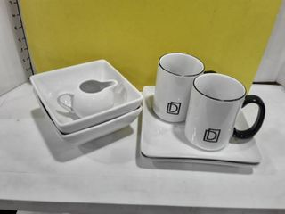 2 mugs 2 plates  2 bowls and a creamer  All colored white
