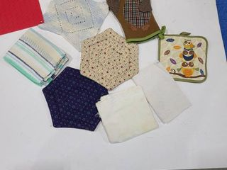 Assorted potholders and kitchen towels