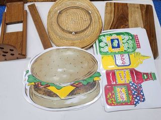 Assorted placemats  cutting board  microwave plate and paper towels holder