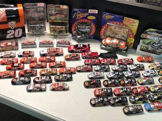 Over Sixty Tony Stewart Action 1 64 Scale Race Cars with Bonus lunchbox with some New in Package