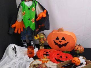 lot of assorted Halloween decorations including an animatronic pumpkin  2 hanging pumpkin  ghost and a light up pumpkin