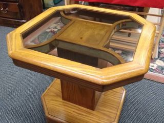 Wooden end table with octagon shaped glass top 22 in H X 26 in W X 26 in D