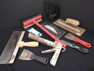 lot of assorted tools including a caulk gun  grout  tiling sponge  grout float and putty knives