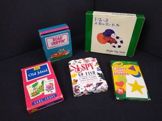 lot of children s card games including I spy  Road trippin  old maid and a sports themed hanging peg hook