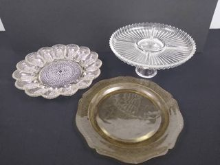 glass deviled egg server  standing divided platter 5 in H and a yellow tinted serving platter