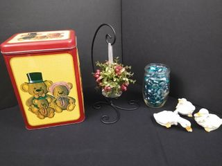 lot of assorted home decor including 3 duck figurines  hanging mistletoe and vintage tin canister  tallest is 9 in H