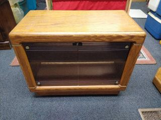 2 door small entertainment center with 2 shelves 24 in H X 30 in W X 16 in D