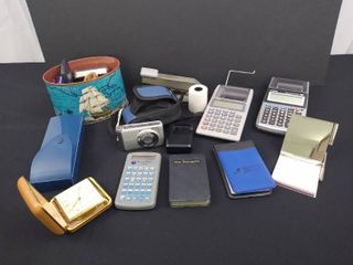 lot of misc  office supplies including 4 calculators  a stapler and a Canon 12 1 mega pixel digital camera with case
