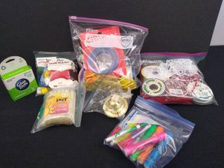 lot of arts and crafts including ribbon  glue dots and glue sticks