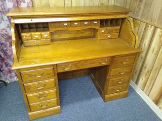 Broyhill roll top desk with lots of built in storage space 45 in X 54 in W x 28 in D