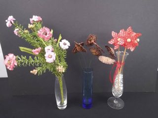 lot of 3 assorted skinny home decor vases with floral arrangements  tallest is 10 1 2 in H