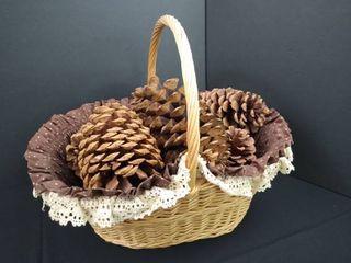 large wooden basket of decorative pine cones