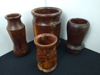 Set of 4 woodcraft vases  tallest is 9 in H