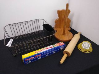 lot of kitchenware including a dish drying rack  paper towel holder  timer and rolling pin
