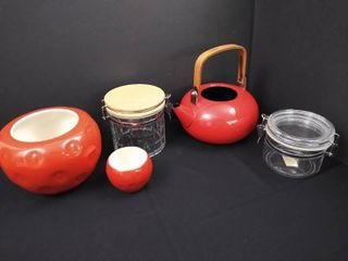 lot of misc  kitchen items including 2 canisters  2 strawberry bowls with no covers and a tea pot