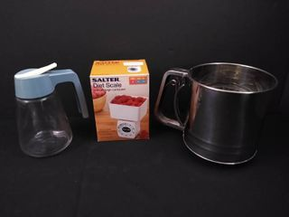 lot of kitchen items including a diet scale  braun food processor  syrup dispenser and a sifter