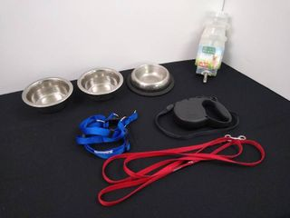 3 dog bowls  2 leashes  dog harness  size small  and a dog bottle waterer