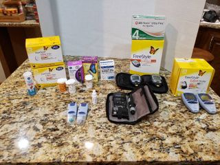 large lot of Assorted Diabetics Supplies   Includes Readers  Sensors  Needles   More